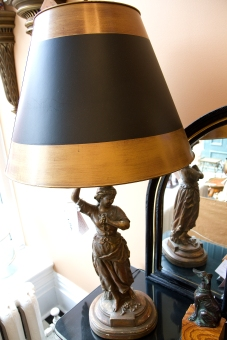 $895 for both. Pair of tall gilded figured plaster lamps depicting a man and a woman with black and gold decorated shades and elegant bronze finials.
