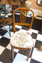 $125 Vintage Thonet-style bentwood chair with lyre back and covered seat.