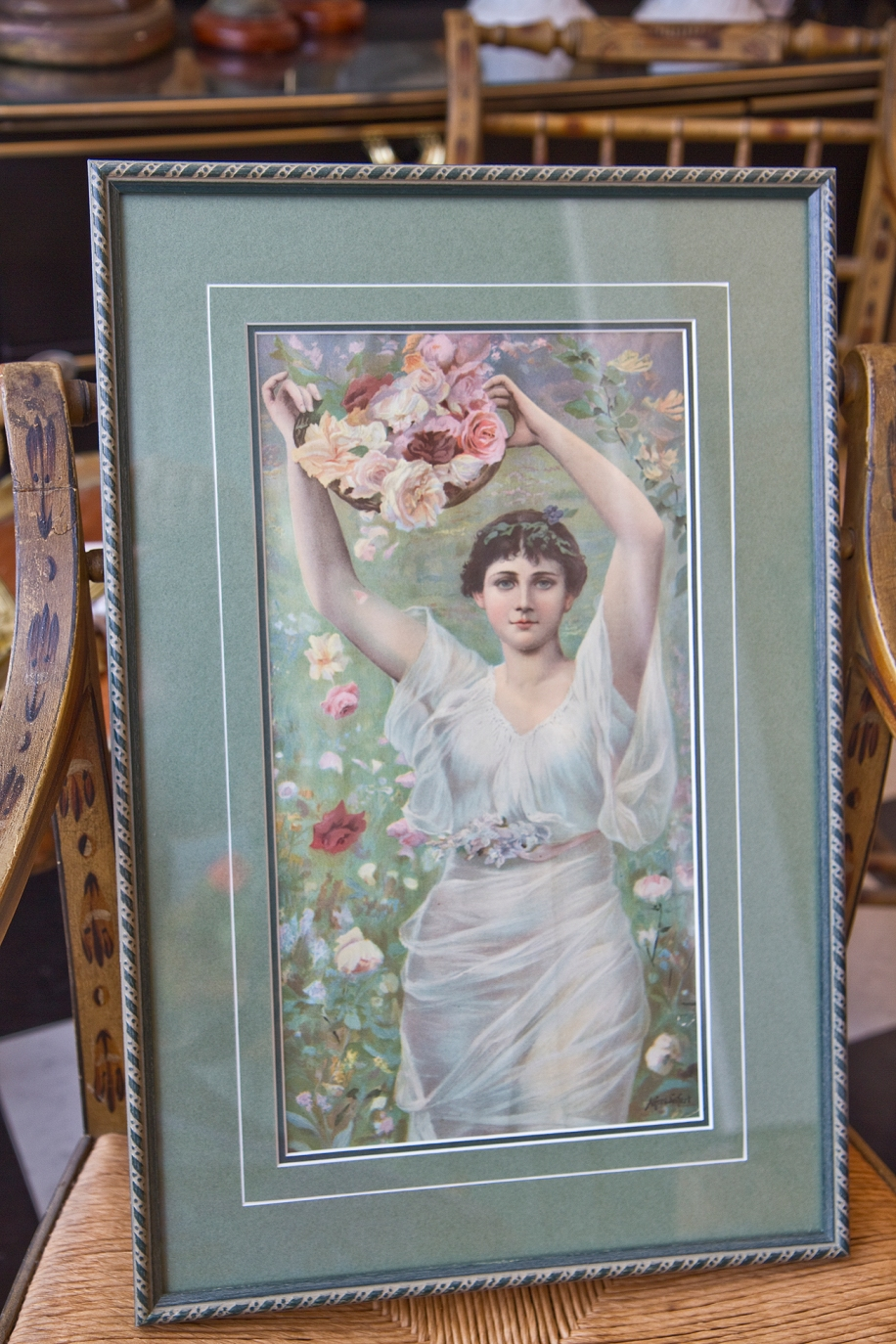 $125 Print of woman holding basket of flowers. Matted and framed.