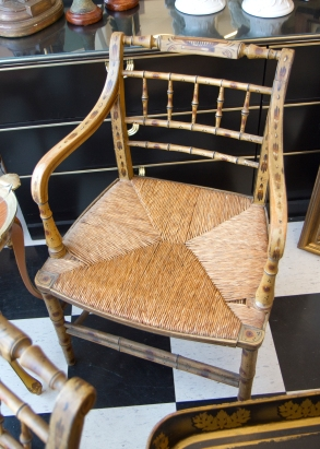 $895 for both. Unique pair of antique country painted wood and rushed seat armchairs with bamboo-style back.