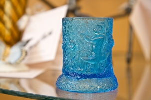 Blue pressed glass toothpick holder with monkeys climbing stump. U.S. Glass Co. 1904.