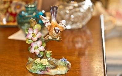 $30 Crown Staffordshire JT Jones bone china figurine of bird on a branch