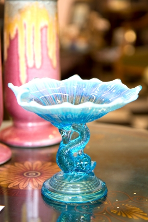 Blue opalescent glass dish with dolphin stem. Late 19th century.