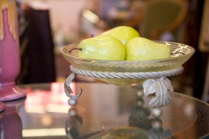 $50 Ribbed glass serving bowl on ornate metal stand.