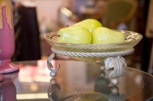 Ribbed glass serving bowl on ornate metal stand.