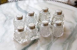 $25 each. Button top crystal salt and pepper sets