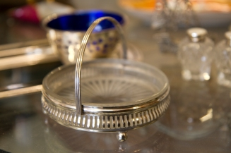 Antique pressed glass dish in sterling silver basket.