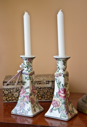 $65 Pair of porcelain glazed flower decorated candle holders