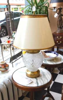 $195 Decorative table lamp with lalique style frosted glass body on gilt metal base. Gold trimmed parchment shade.