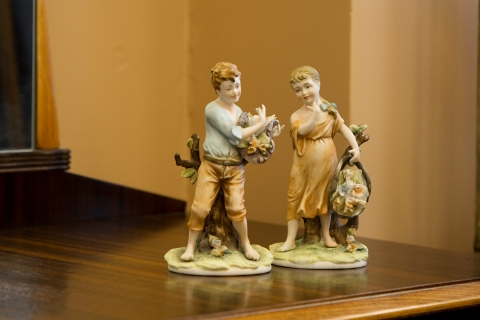 Hand-painted figurines of boy and girl collecting flowers. Made in Japan. Sold separately