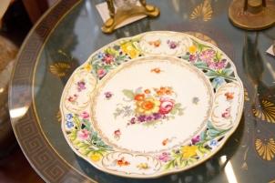 Vintage floral design plate. Gold trim