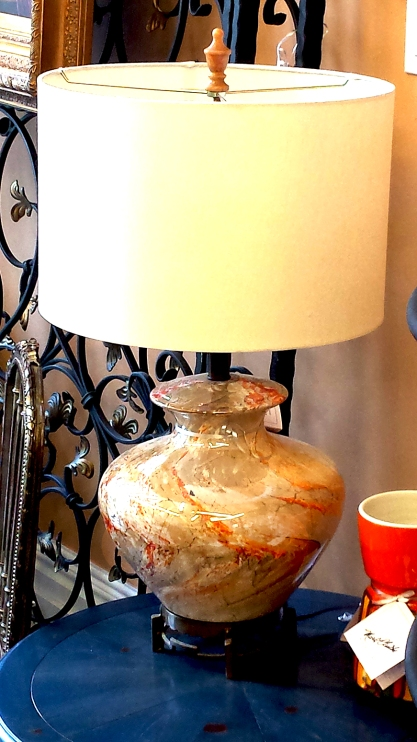 $225 Large, round lamp. Café au lair boldly streaked with orange sitting on a beautiful brass base. A marble finial adorns the canvas shade.