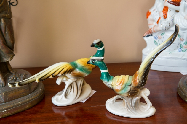 Ring neck pheasant figurines.