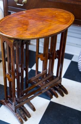 Set of four antique walnut nesting tables. Circa 1900.