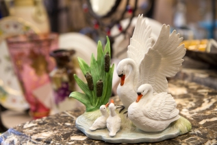 $45 Swan family figurine. Parents with two cygnets and bullrushes.