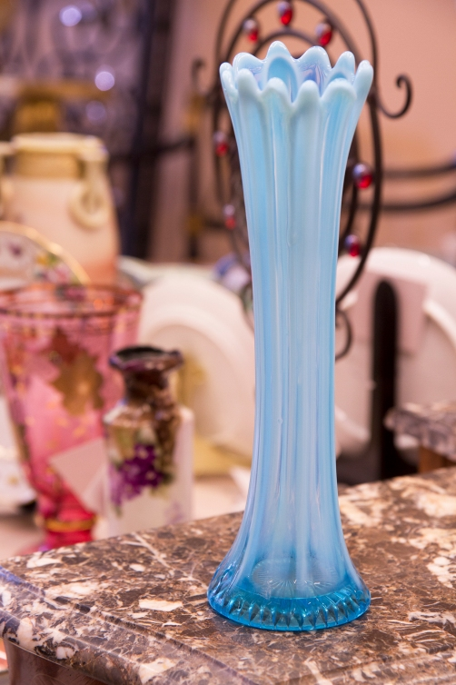 $45 Blue opalescent glass vase with petal pattern. Circa 1906.