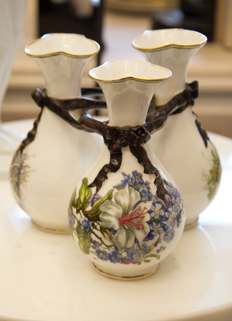 $55 A trio of vases depicting different seasons tied together with ribbon.
