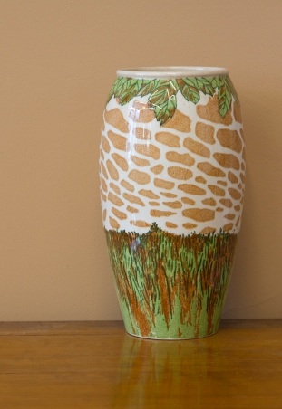 $135 Unique vase depicting giraffe spots and grasslands. Early to mid-century