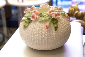 $50 Vintage round white porcelain vase with dotted Swiss raised relief and sculpted roses. Circa 1960s.