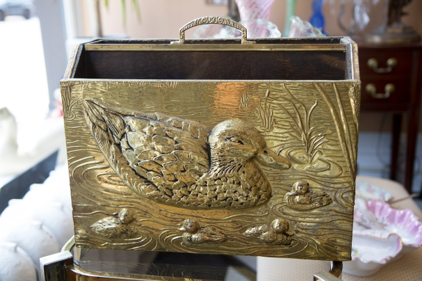 $65 Vintage hammered brass over wood magazine rack with a duck family scene on the front.