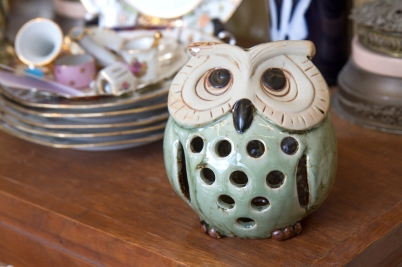 $30. Light green and and brown partly-glazed ceramic owl.