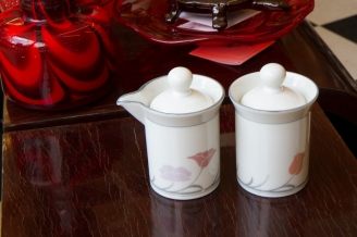 $40. Dansk Tivoli creamer and sugar bowl with lids. Belles Fleurs pattern. Discontinued in the 1980s.