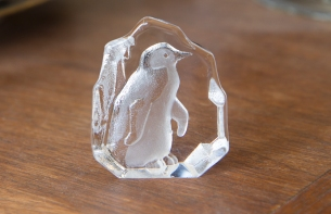 $25. Small signed Nybro Sweden crystal penguin paperweight.