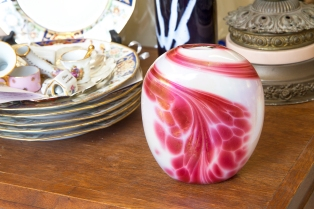 $65. Signed by BC artist Robert Held, frosty white with pink vase. Iridescent finish. 1980s