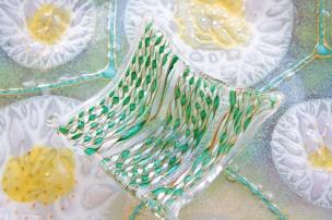 $135. Mid-century Murano glass Latticino green ribbon art dish.