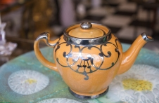 $135. Ohio Pottery Art Nouveau teapot with Sterling silver overlay. U.S.A. Early 1900s.