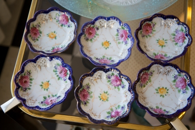 $145 Set of six small Nippon scalloped dishes with hand-painted roses. Cobalt blue edging and gold trim. Circa 1890s-1930.