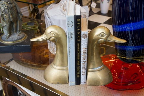 $85 Pair of mid-century solid brass duck head bookends