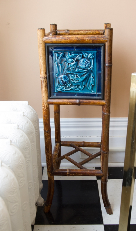 $445. Antique faux bamboo frame with Chinoiserie style pierced shelf and four teal blue vintage tiles with fruit and floral motif. Early 20th