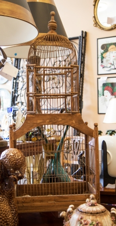 $475. Vintage wood framed bird cage with knotted wire enclosure and tin fittings for food and water. Early 20th century.