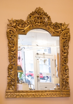 $1,200. Ornately carved contemporary gilt wood framed mirror.