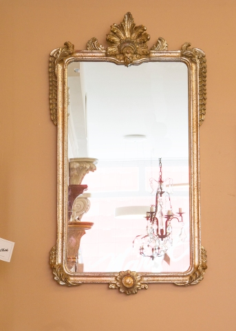 $395. Contemporary giltwood mirror with applied carved and gilded embellishment.