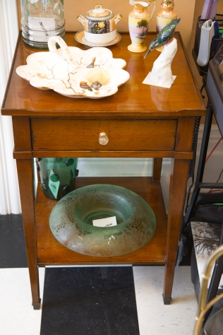 $625. Pecan mid-century side table with shelf, drawer and raised edge. Round crystal glass drawer pull.