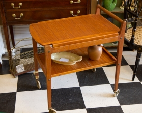 $395. Mid-century Scandinavian two-tier teak drinks cart with removable tray. (repair to one leg)